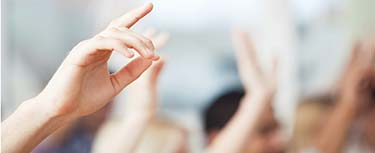 Image of hands up in lesson Preparing to teach event materials: Download now