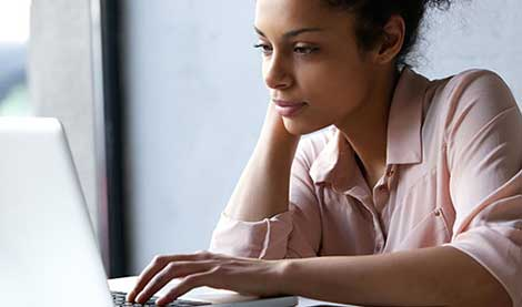 Woman looking at laptop screen