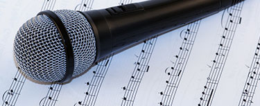 image of microphone and songsheet See our accredited AS and A-level specifications