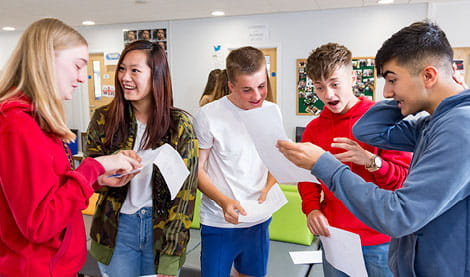 five students reacting to exam results